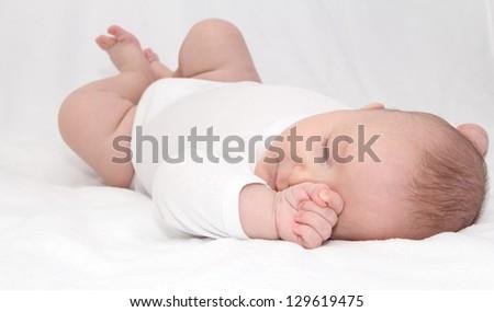 Beautiful sleeping newborn baby - close up - stock photo