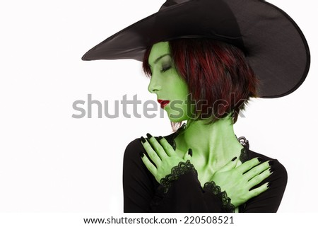 Beautiful sleeping witch with green skin on white background. Space for text in left part of image. Halloween, horror theme - stock photo