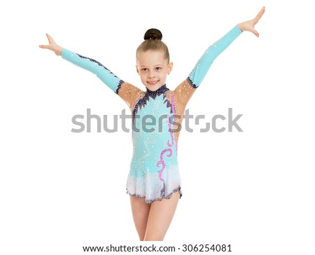 Beautiful slender little girl gymnast in the sport bathing suit does exercises-Isolated on white background - stock photo