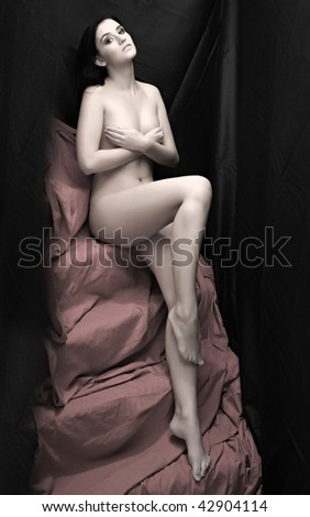 Beautiful slenderness young woman on pink background. Low key studio shot. Great for calendar. - stock photo