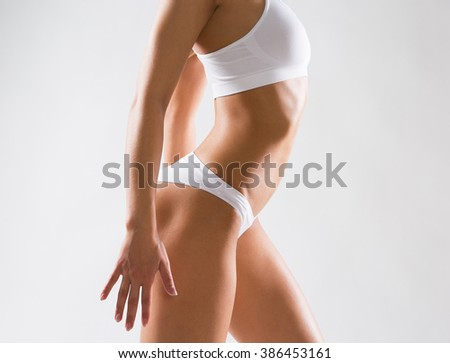 Beautiful slim body of a woman in lingerie - stock photo