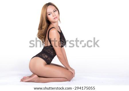 Beautiful slim body of woman in studio - stock photo