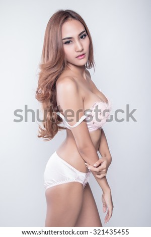 Beautiful slim body of woman in studio, white background