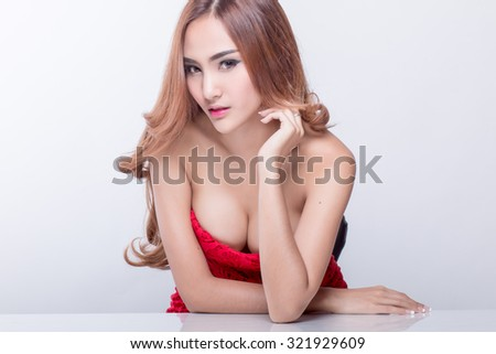 Beautiful slim body of woman in studio, white background, red dress. - stock photo