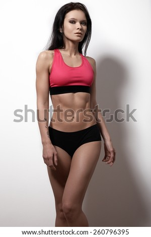 Beautiful slim female body. Voluptuous woman's shape with clean healthy skin, flat stomach, waist. Perfect sports female model. Healthy lifestyle, diet and fitness - stock photo
