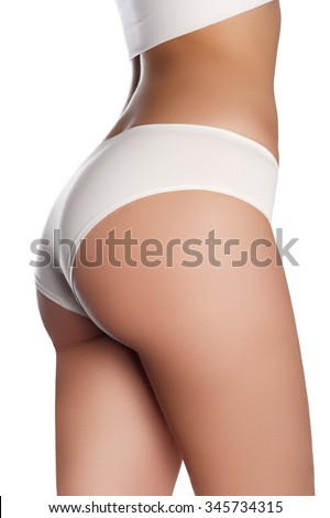Beautiful slim female body. Voluptuous woman's shape with clean healthy skin, sexy back. Spa beauty part of body. Healthy lifestyle, diet and fitness. Perfect waist, butt and legs - stock photo