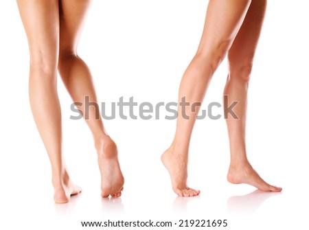 beautiful slim female legs isolated on white - stock photo
