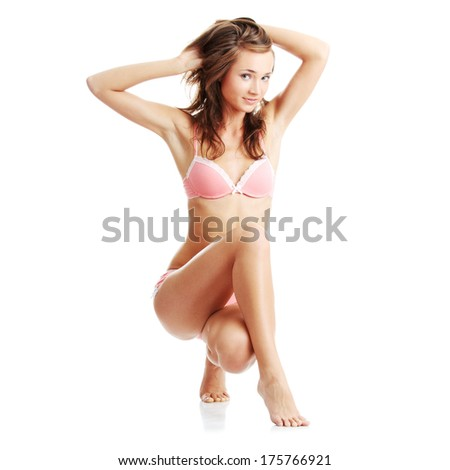 Beautiful,slim, fit and sexy Caucasian woman in pink underwear isolated  - stock photo