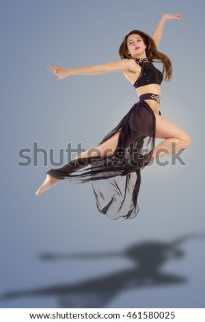 Beautiful slim girl gymnast. modern style ballet dancer posing and jumping on training. Young sexy woman exercise pole dance against. young, cute and beautiful ballet dancer posing.