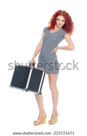 Beautiful slim girl with a black suitcase. Isolated on white.