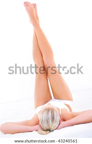 Beautiful slim long woman's legs over white background - stock photo