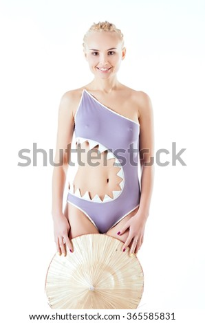 Beautiful slim model in gray swimsuit with nude tummy - stock photo