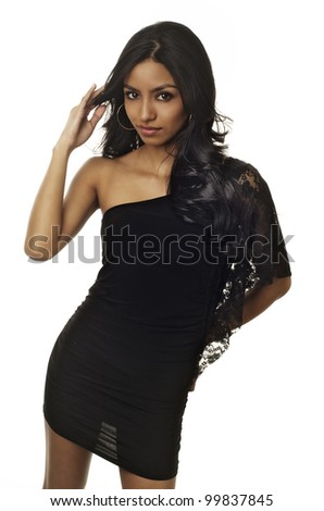 Beautiful slim petite young woman in black dress.  Image isolated against white background. - stock photo