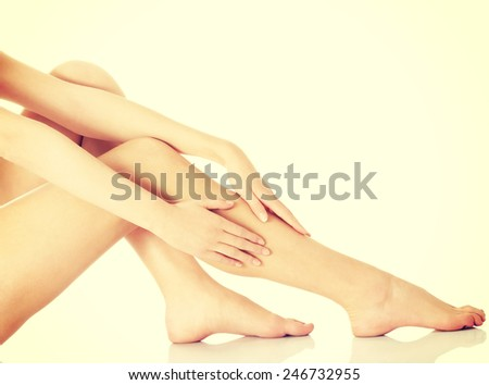 Beautiful slim shaved woman's legs.  - stock photo