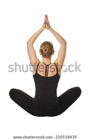 Beautiful slim woman doing yoga. Isolated on white background. Girl meditates in a pose of a pigeon. - stock photo