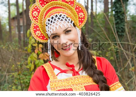 Beautiful slim woman in an old Russian dress