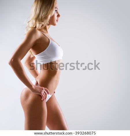 Beautiful slim woman in lingerie - stock photo