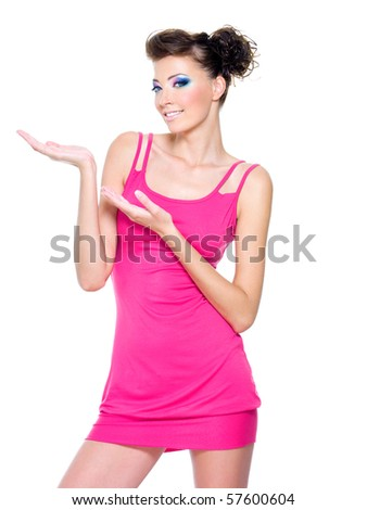 Beautiful slim woman posing in pink dress isolated on white with hands lifted upwards
