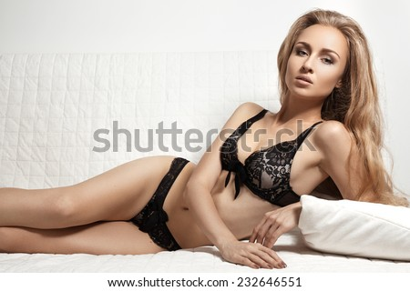 Beautiful slim woman's body. Underwear model, sensual body. Beautiful lacy lingerie. Perfect voluptuous shapes and curves. Healthy lifestyle, diet and sport  - stock photo