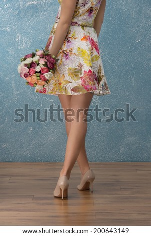 Beautiful slim womans legs in high heels shoes are power for seducing men - stock photo