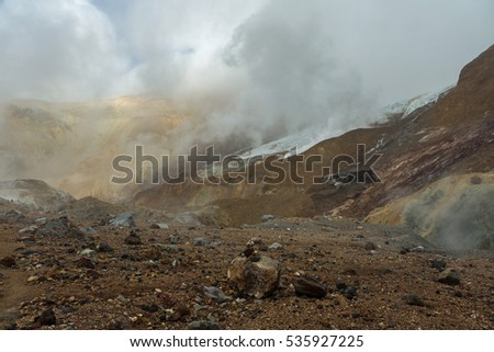 Beautiful slopes of Mutnovsky volcano shrouded in clouds.