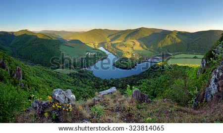 Beautiful Slovakian panoramic landscape with a rock and river down in the valley. Kosice area - stock photo