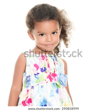 Beautiful small african-american or hispanic girl wearing a flowers summer dress isolated on white - stock photo