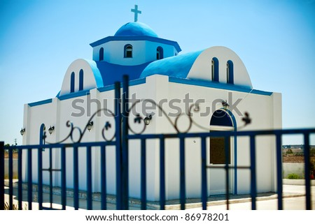 beautiful small church behind the fence, somewhere on island Kos, Dodecanese, Greece - stock photo