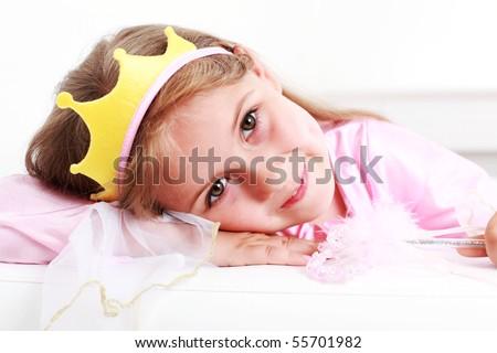 Beautiful small girl dressed as princess - stock photo