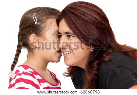 Beautiful small girl telling a secret to her latin mother isolated on a white background