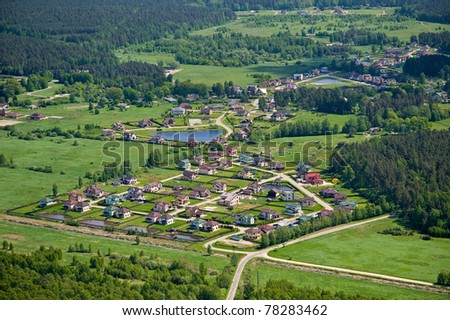 Beautiful small green village from above - stock photo