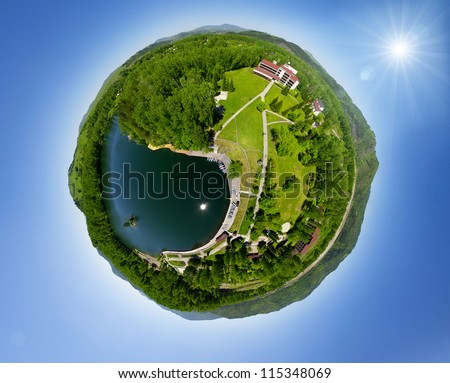 Beautiful small green village from above (aerial view) little planet concept - stock photo