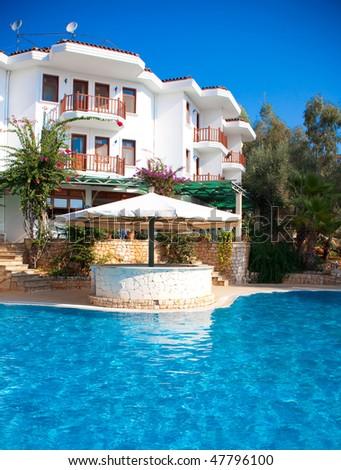 Beautiful small hotel at the mediterranean sea in Turkey - stock photo