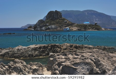 Beautiful small island with a church of Saint Stefanos in Kefalos town harbour on the island of Kos, Greece - stock photo