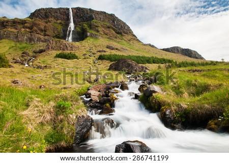 Beautiful small waterfall on Iceland and a brook. Snaefellsness peninsula - stock photo