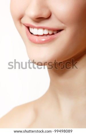 Beautiful smile of young fresh woman with great healthy white teeth. Isolated over white background - stock photo
