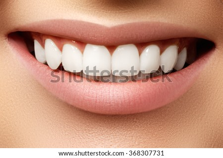 Beautiful smile of young fresh woman with great healthy white teeth. Perfect smile after bleaching. Dental care and whitening teeth - stock photo