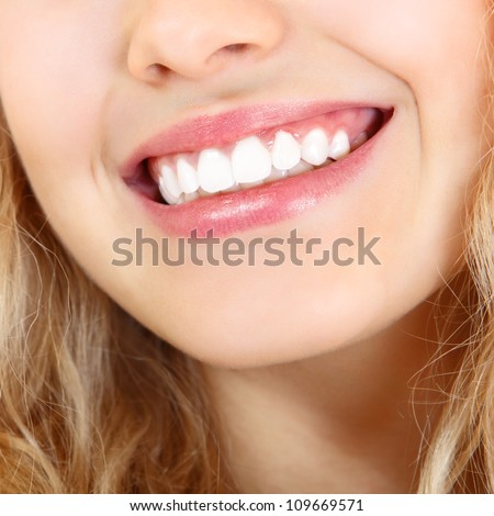Beautiful smile of young fresh woman with healthy white teeth. Isolated over white background - stock photo