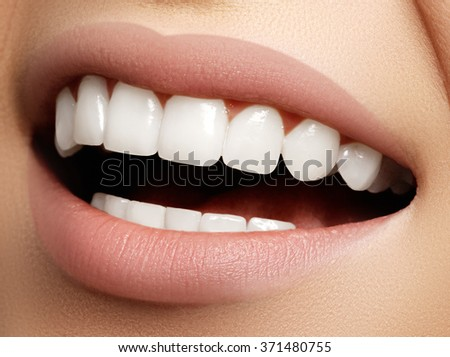 Beautiful smile with whitening teeth. Dental photo. Macro closeup of perfect female mouth, lipscare