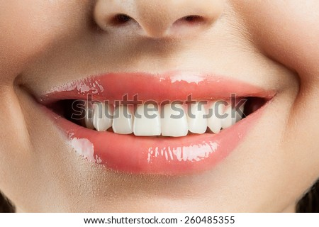 Beautiful smile with withe teeth - stock photo