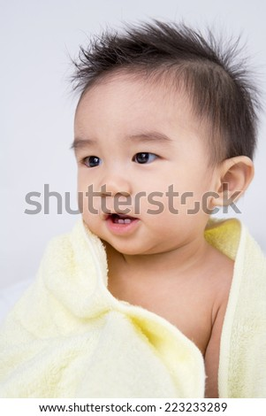 Beautiful smiling asian cute baby,Little boy with yellow  bath towel