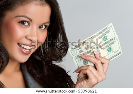 Beautiful smiling asian woman holding money - stock photo