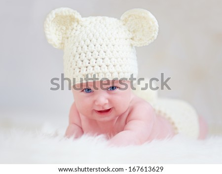 beautiful smiling baby in cute hat - stock photo