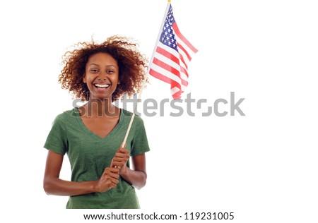 Beautiful smiling black hispanic / latin mixed woman holding american flag isolated over white background - stock photo
