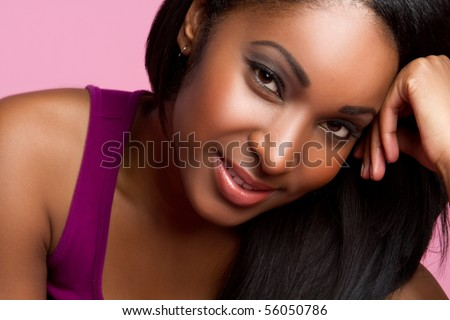 Beautiful smiling black woman closeup - stock photo
