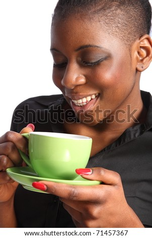 Beautiful smiling black woman drinking cup of tea - stock photo