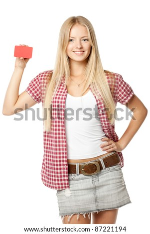 Beautiful smiling blond female in casual holding blank card over white background - stock photo