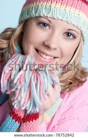 Beautiful smiling blond winter girl - stock photo