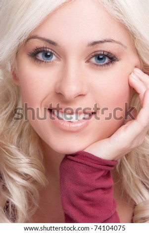 Beautiful smiling blond woman face - stock photo