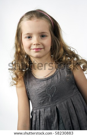 beautiful smiling blonde little girl - stock photo